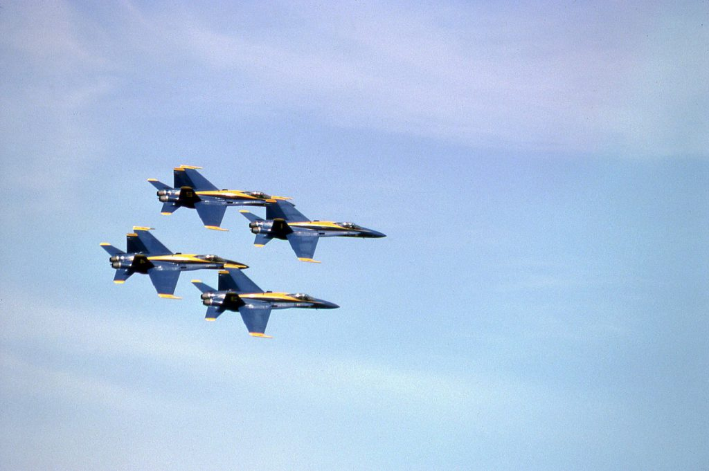 Four of the Navy's Blue Angels performing over San Francisco on Fleet Week.